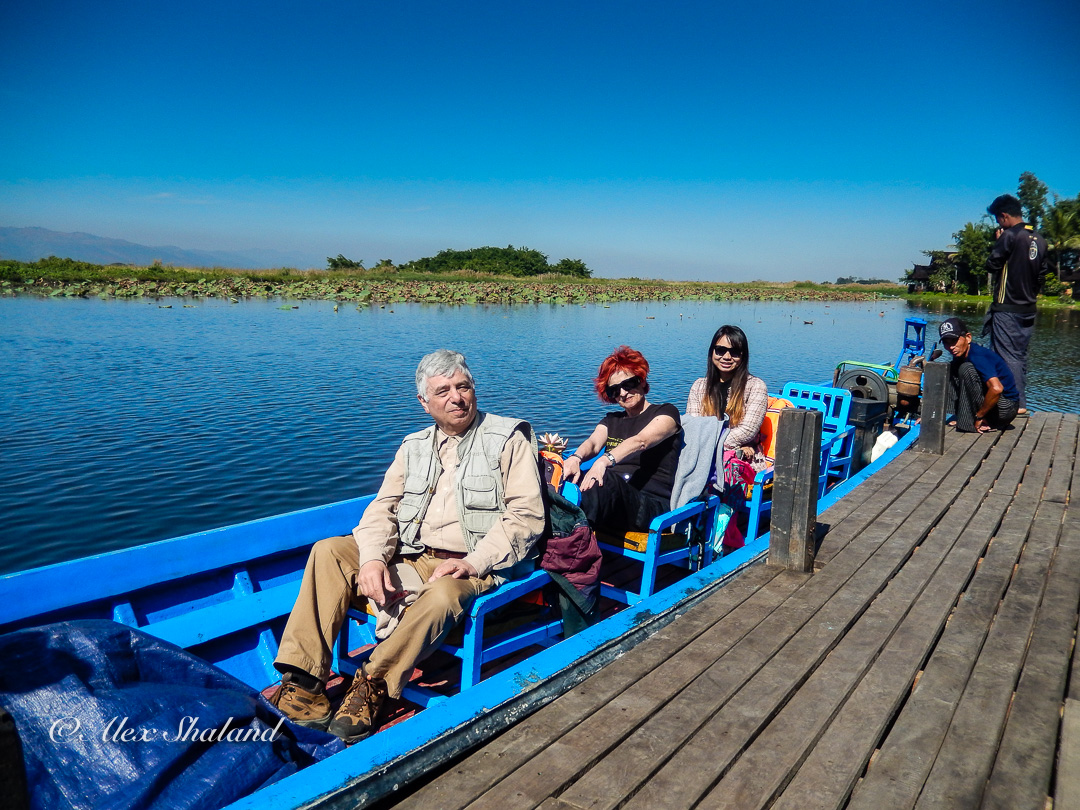 Irene and Alex shaland and travel guide in the boat on Inle Lake